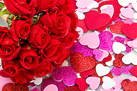 Bouquet of artifical red roses with background of valentines.