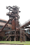 Blast furnaces of Vítkovice Iron and Steel Works, Ostrava, Czech Republic. .This site has been declared an Industrial Heritage Site by the Ministry of Culture and is a unique example of industrial architecture from the first half of the 19th century. The site was occupied by a puddle furnace from 1828. It was founded by archduke Rudolf and was the first one of its kind in the entire Austrian Empire. The first blast furnace began production in 1836, and the Hlubina coal mine was opened in 1843. Soon the site provided for an entire industrial process from start to finish, from the mining of coal as a raw material, through the manufacture of coke, to its use in the production of iron.This continued uninterrupted until 1998.