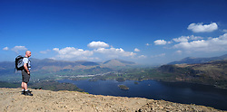 File photo dated 19/04/09 of a walker at the summit of Cat Bells fell looking over Derwent Water towards Keswick in the Lake District, as the Lake District has been designated as a World Heritage Site, Unesco has said.