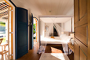 Private home in Parati Brazil. View of the master bedroom from the doorway.