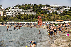 People enjoy the sun and the sea during the official reopening of organized beaches to the public in Athens on May 16, 2020. Hundreds of organized beaches opened to the public on 16 May, though they are to operate subject to strict health and safety guidelines due to the coronavirus pandemic, amid forecasts of a record heat wave<br /> <br /> Pictured: <br /> Dimitris Lampropoulos  | EEm date