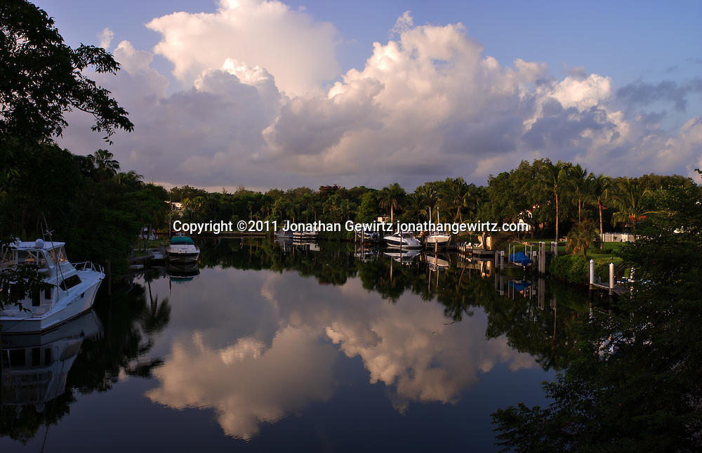 Panoramic view during early morning hours of a peaceful canal with private boats and luxurious homes on either side in Coral Gables, Florida. WATERMARKS WILL NOT APPEAR ON PRINTS OR LICENSED IMAGES.
