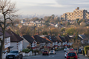 Suburban homes, flats and parked cars with a cityscape looking north from Horniman Hill towards the prominent residential complex of Dawson Heights in East Dulwich, on 23rd November 2020, in London, England.