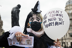 A clown joins fellow climate activists from Extinction Rebellion attending a 'Carnival of Corruption' protest against the government's facilitation and funding of the fossil fuel industry on 3 September 2020 in London, United Kingdom. Extinction Rebellion activists are attending a series of September Rebellion protests around the UK to call on politicians to back the Climate and Ecological Emergency Bill (CEE Bill) which requires, among other measures, a serious plan to deal with the UK's share of emissions and to halt critical rises in global temperatures and for ordinary people to be involved in future environmental planning by means of a Citizens' Assembly.