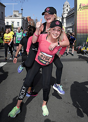 Competitor Aimee Fuller and her Mum cross the finish linne during the 2019 London Landmarks Half Marathon.