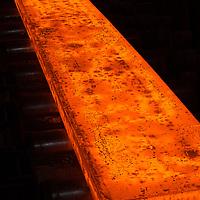 Teesside - British Steel - Hot glowing orange large steel plate on the steel mill
