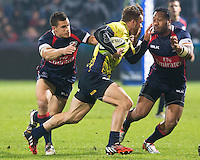 Adam Siddall (L) and Andrew Suniula (R) of USA tries to stop Csaba Gal (C) of Romania during their  rugby test match between Romania and USA, on National Stadium Arc de Triomphe in Bucharest, November 8, 2014.  Romania lose the match against USA, final score 17-27.