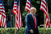 """President Donald Trump arrives for a """"Celebration of America"""" event on the South Lawn of the White House on June 5, 2018 in Washington, DC. The celebration is being staged as a replacement for a White House visit by the Super Bowl champion Philadelphia Eagles. Some of the team was planning on boycotting the event due to the President's stance on players kneeling during the National Anthem at NFL games, so Trump resented their invitation.      Photo by Pete Marovich/UPI"""