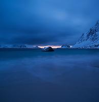 Winter night arrives at Haukland Beach, Vestvågøy, Lofoten Islands, Norway