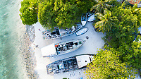 Aerial view of abandoned boats, dhonis at the local shore of local island Omadhoo, Alif Dhaal Atoll, Maldives, Indian Ocean