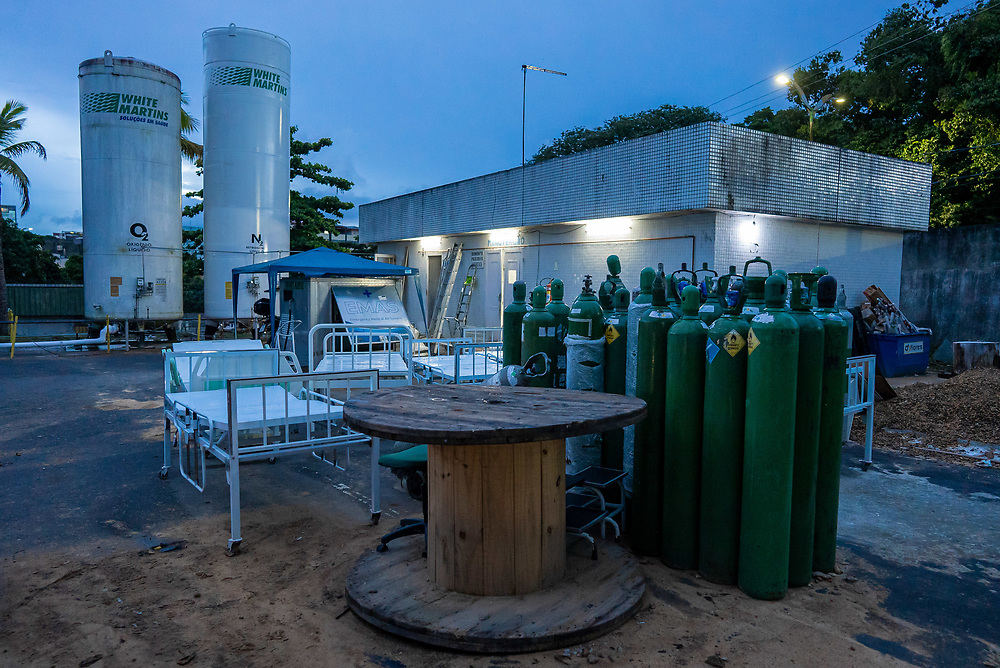 """Oxygen cylinders are stacked up at the rear of """"August 28""""  hospital in Manaus, Brazil March 29, 2021. March has been the worst month in number of deaths for Brazil as the number climbs to more than 300k deaths. Amazonas state has more than 12,000.  Photo Ken Cedeno"""