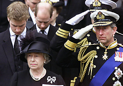 File photo dated 09/04/02 of Queen Elizabeth II, watching as the coffin containing the body of the Queen Mother is put into a hearse following her funeral service at Westminster Abbey, London. The monarch addressed the nation on the eve of her mother???s funeral to thank the country for their support and the love and honour shown to the 101-year-old. Issue date: Friday April 16, 2021.