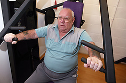 Access to services, Disabled man in the gym; using Chest Press,
