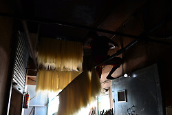 June 16, 2017 - Allahabad, India - In this picture taken on June 16,2017,An  Indian worker dries vermicelli,a traditional sweet dish , ahead of Eid Al Fitr festival , at a factory , in the old streets of Allahabad. Muslims throughout the world are marking the month of Ramadan, the holiest month in the islamic calender.Eid Al -Fitr (feast of breaking the fast) is an important religious festival celebrated by muslims worldwide that marks the end of Ramadan, the islamic holy month of fasting. (Credit Image: © Ritesh Shukla/NurPhoto via ZUMA Press)