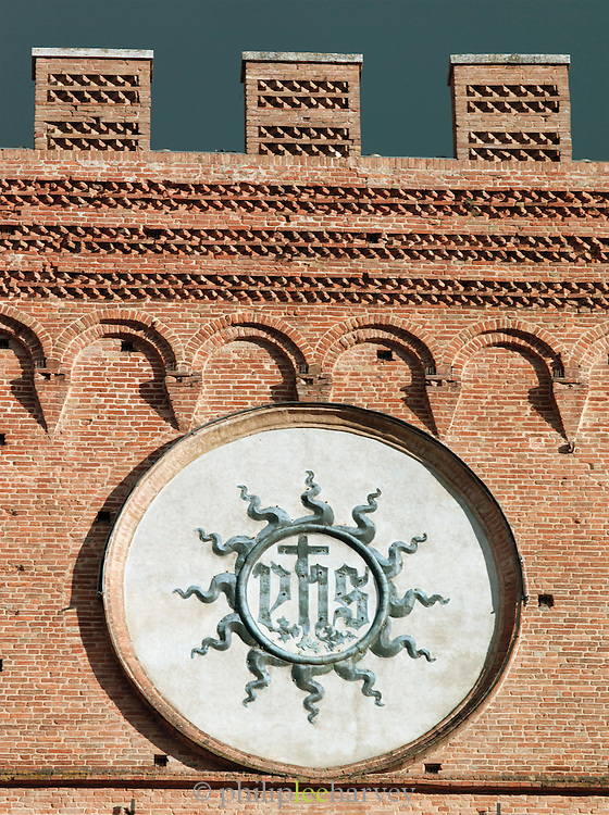 Detail of the Palazzo Publico on the Piazza del Campo in Siena, Tuscany, Italy
