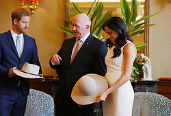 The Duke and Duchess of Sussex look at bush hats with Australia's Governor General Peter Cosgrove at Admiralty House in Sydney on the first day of the royal couple's visit to Australia.