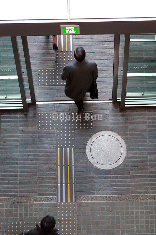 overhead view of businesspeople leaving office building