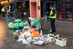 © Licensed to London News Pictures. 18/06/2021. London, UK.  Dustman clean up after Scotland fans gather in Leicester Square before the Euro 2020 fottball match with England. Photo credit: Ray Tang/LNP