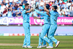 Chris Woakes of England celebrates with teammates after taking the wicket of Rohit Sharma of India - Mandatory by-line: Robbie Stephenson/JMP - 30/06/2019 - CRICKET - Edgbaston - Birmingham, England - England v India - ICC Cricket World Cup 2019 - Group Stage