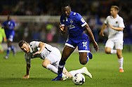 Darius Osei of Oldham Athletic is fouled by Zander Diamond of Northampton Townduring the EFL Sky Bet League 1 match between Oldham Athletic and Northampton Town at Boundary Park, Oldham, England on 16 August 2016. Photo by Simon Brady.