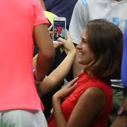 2017 U.S. Open Tennis Tournament - DAY TWO. Fans take pictures of Rafael Nadalof Spain after his win against DusanLajovic of Serbia during the Men's Singles round one match at the US Open Tennis Tournament at the USTA Billie Jean King National Tennis Center on August 29, 2017 in Flushing, Queens, New York City.  (Photo by Tim Clayton/Corbis via Getty Images)