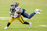 NASHVILLE, TN - OCTOBER 25:  Diontae Johnson #18 of the Pittsburgh Steelers is tackled in the second half after catching a pass by Tye Smith #23 of the Tennessee Titans at Nissan Stadium on October 25, 2020 in Nashville, Tennessee.  The Steelers defeated the Titans 27-24.  (Photo by Wesley Hitt/Getty Images) *** Local Caption *** Diontae Johnson; Tye Smith