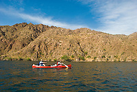 Canoers paddle there way through The Black Canyon, Nevada.