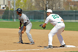 17 April 2016:  Nick Sotiros takes a short lead from 1st base and Tim Smyk during an NCAA division 3 College Conference of Illinois and Wisconsin (CCIW) Pay in Baseball game during the Conference Championship series between the North Central Cardinals and the Illinois Wesleyan Titans at Jack Horenberger Stadium, Bloomington IL