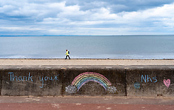 View of  chalk drawings with rainbows for the NHS on Portobello  promenade during coronavirus lockdown April 2020. Scotland, UK