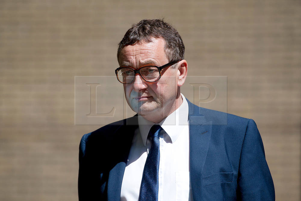 © London News Pictures. 05/06/2013. London, UK. Former News of the World news editor, JAMES WEATHERUP, leaving Southwark Crown Court in London where he faced charges relating to phone hacking scandal at the News of The World. Photo credit: Ben Cawthra/LNP  Three former News of the World staff have pleaded guilty to charges related to hacking phones, the trial of Rebekah Brooks and Andy Coulson heard.<br /> <br /> The court was told on that ex-chief correspondent Neville Thurlbeck, former assistant news editor James Weatherup, and ex-news editor Greg Miskiw had pleaded guilty to conspiracy to intercept communications at earlier hearings