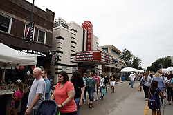 11 July 2015:  The crowds swell the streets as the parking lots become full for the 2015 Sugar Creek Arts Festival in Uptown Normal Illinois