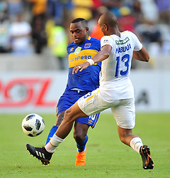 Cape Town--180401  Mamelodi Sundowns midfielder Tiyane Mabunda  challenges by Ayanda Patosi  of Cape Town City during the Nedbank Cup quarter final game at the Cape Town Stadium.Sundowns won the game 2-1 and will play maritzburg in the Semi-final  .Photographer;Phando Jikelo/African News Agency/ANA