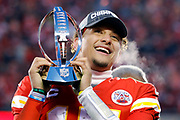 Kansas City Chiefs quarterback Patrick Mahomes holds the Lamar Hunt Trophy during celebrations after winning the NFL, AFC Championship football game against the Tennessee Titans, Sunday, Jan. 19, 2020, in Kansas City, MO. The Chiefs won 35-24 to advance to Super Bowl 54. (AP Photo/Colin E. Braley) Colin Eric Braley Photography