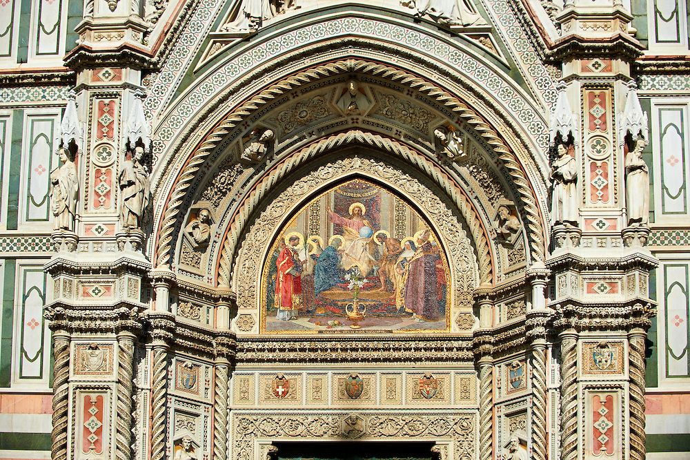 The main central door ( Porta Maggiore ) mosaic and the fine Gothic architectural detail of  the  of the Gothic-Renaissance Duomo of Florence,  Basilica of Saint Mary of the Flower; Firenza ( Basilica di Santa Maria del Fiore ).  Built between 1293 & 1436. Italy .<br /> <br /> Visit our ITALY PHOTO COLLECTION for more   photos of Italy to download or buy as prints https://funkystock.photoshelter.com/gallery-collection/2b-Pictures-Images-of-Italy-Photos-of-Italian-Historic-Landmark-Sites/C0000qxA2zGFjd_k<br /> .<br /> <br /> Visit our MEDIEVAL PHOTO COLLECTIONS for more   photos  to download or buy as prints https://funkystock.photoshelter.com/gallery-collection/Medieval-Middle-Ages-Historic-Places-Arcaeological-Sites-Pictures-Images-of/C0000B5ZA54_WD0s