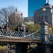 Lagoon bridge and Hancock Tower behind in Public Garden of Boston