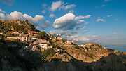 A view of the village of Savoca, Sicily, Italy. The town was the location for the scenes set in Corleone of Francis Ford Coppola's The Godfather. Bar Vitelli in Savoca, which is still a functioning establishment, was featured in the motion picture as the place where Michael Corleone asked Apollonia's father to meet his daughter.