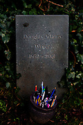 Grave of Douglas Adams (1952-2001), writer of Hitchiker's Guide to the Galaxy in Highgate Cemetry, London, which appears to have become something of a pilgrimage or shrine for fans.<br /> People used to stick pens in the ground, but they've now added a small pot that people can put the pens in.