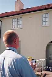 Surveyor making notes on social housing UK