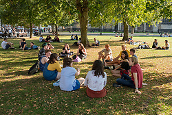 "© Licensed to London News Pictures; 21/09/2020; Bristol, UK. A group of 13 young people sit on College Green. Groups of people, some more than six in number, enjoy the sunshine and hot weather on the last official day of summer in Bristol city centre, amid concerns about a second wave of the covid-19 coronavirus pandemic across the UK, with many areas going into local lock down. From Monday 14 September it was illegal to meet up socially in groups of more than six people, known as the ""Rule of Six"", in order to try and contain the spread of the covid-19 coronavirus pandemic, and police have said they will enforce the law with fixed penalty notices which will increase for repeat offenders. Photo credit: Simon Chapman/LNP."
