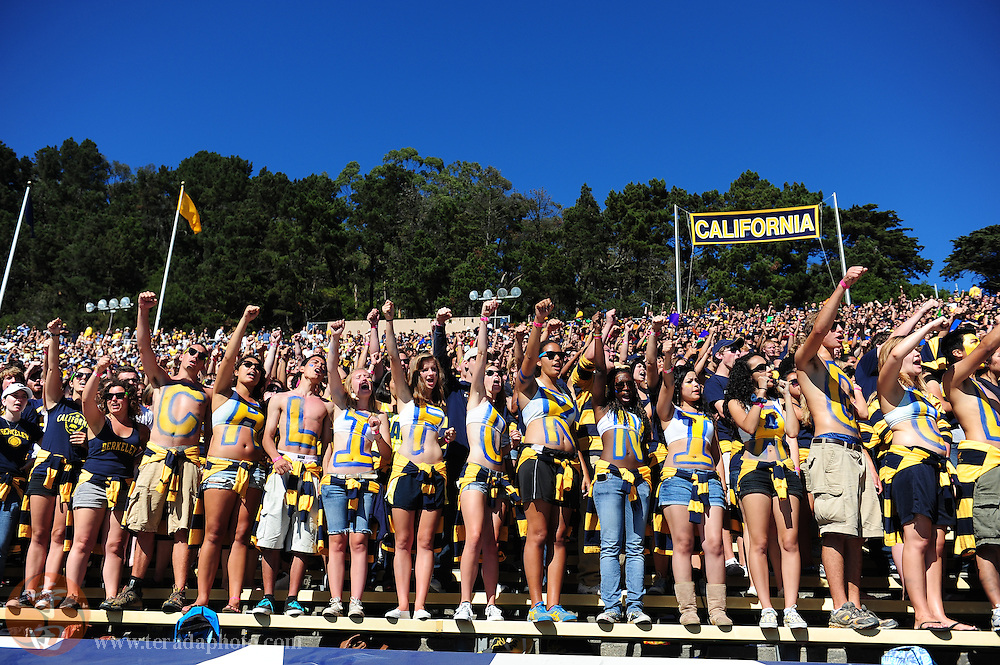 September 4, 2010; Stanford, CA, USA; California Golden Bears students cheer during the fourth quarter against the UC Davis Aggies at Memorial Stadium. California defeated UC Davis 52-3. Mandatory Credit: Kyle Terada-Terada Photo