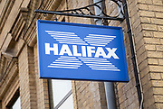 Sign on wall for Halifax bank branch, UK