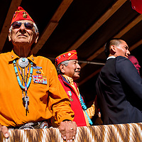 081415       Cable Hoover<br /> <br /> Navajo Codetalker Roy Hawthorne looks out from the front of the float during the Codetalker Day parade Friday in Window Rock.