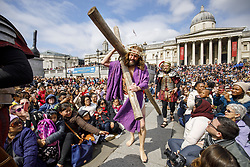 April 14, 2017 - London, UK - London, UK. Actors of the Wintershall Players perform 'The Passion of Jesus' on Good Friday to crowds in Trafalgar Square, London on 14 April 2017. The Wintershall Players are based on the Wintershall Estate in Surrey and perform several biblical theatrical productions per year. Their production of 'The Passion of Jesus' includes a cast of 80 actors, horses, a donkey and authentic costumes of Roman soldiers in the 12th Legion of the Roman Army. (Credit Image: © Tolga Akmen/London News Pictures via ZUMA Wire)