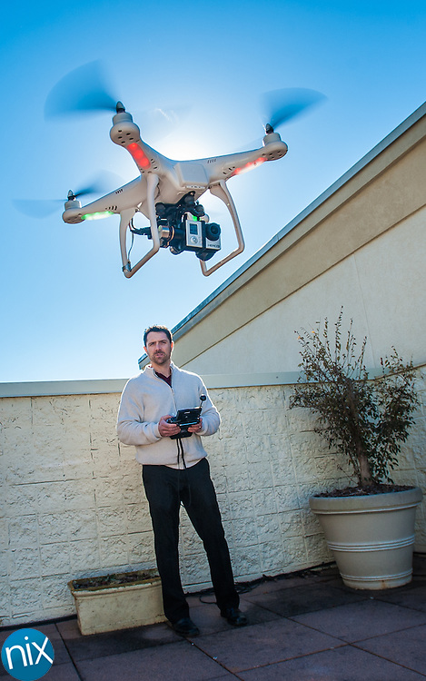 Mike Ouimet, of Aerial Captures, shows off a Radio Controlled Aerial Device his company uses to film aerial video footage for a variety of clients.