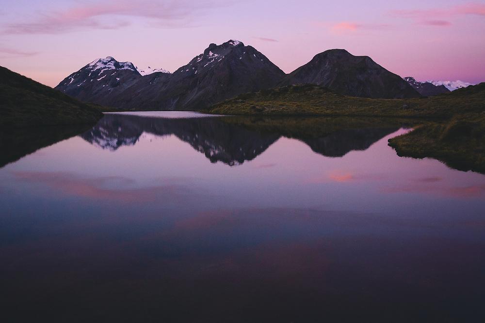 Sunset still over alpine tarn on Sugarloaf pass