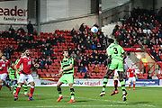 Forest Green Rovers Manny Monthe(3) heads into the box for Forest Green Rovers Darren Carter(12) to score during the Vanarama National League match between Wrexham FC and Forest Green Rovers at the Racecourse Ground, Wrexham, United Kingdom on 26 November 2016. Photo by Shane Healey.