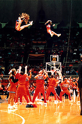 December 18, 2001: University of Illinois Fighting Illini cheerleaders...This image was scanned from a print.  Image quality may vary.  Dust and other unwanted artifacts may exist.