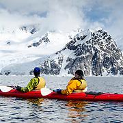 Sea kayakers in calm waters at Neko Harbour, Antarctica.