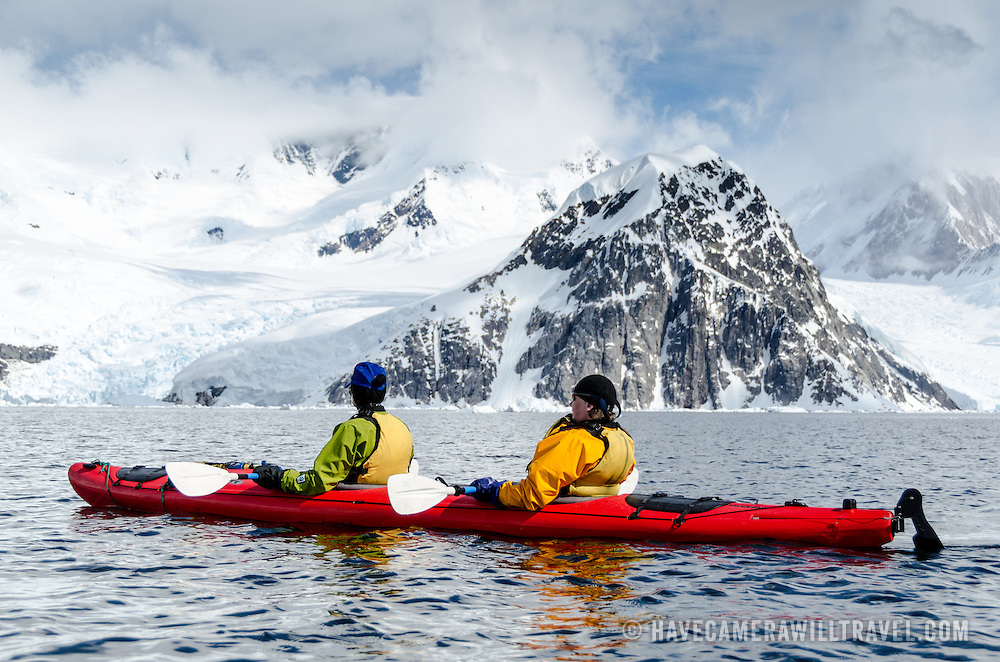 Sea kayakers in calm waters at Neko Harbour, Antarctica.