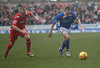 Derek Niven of Chesterfield attacks (right). Sammy Clingan of Forest chases (left)